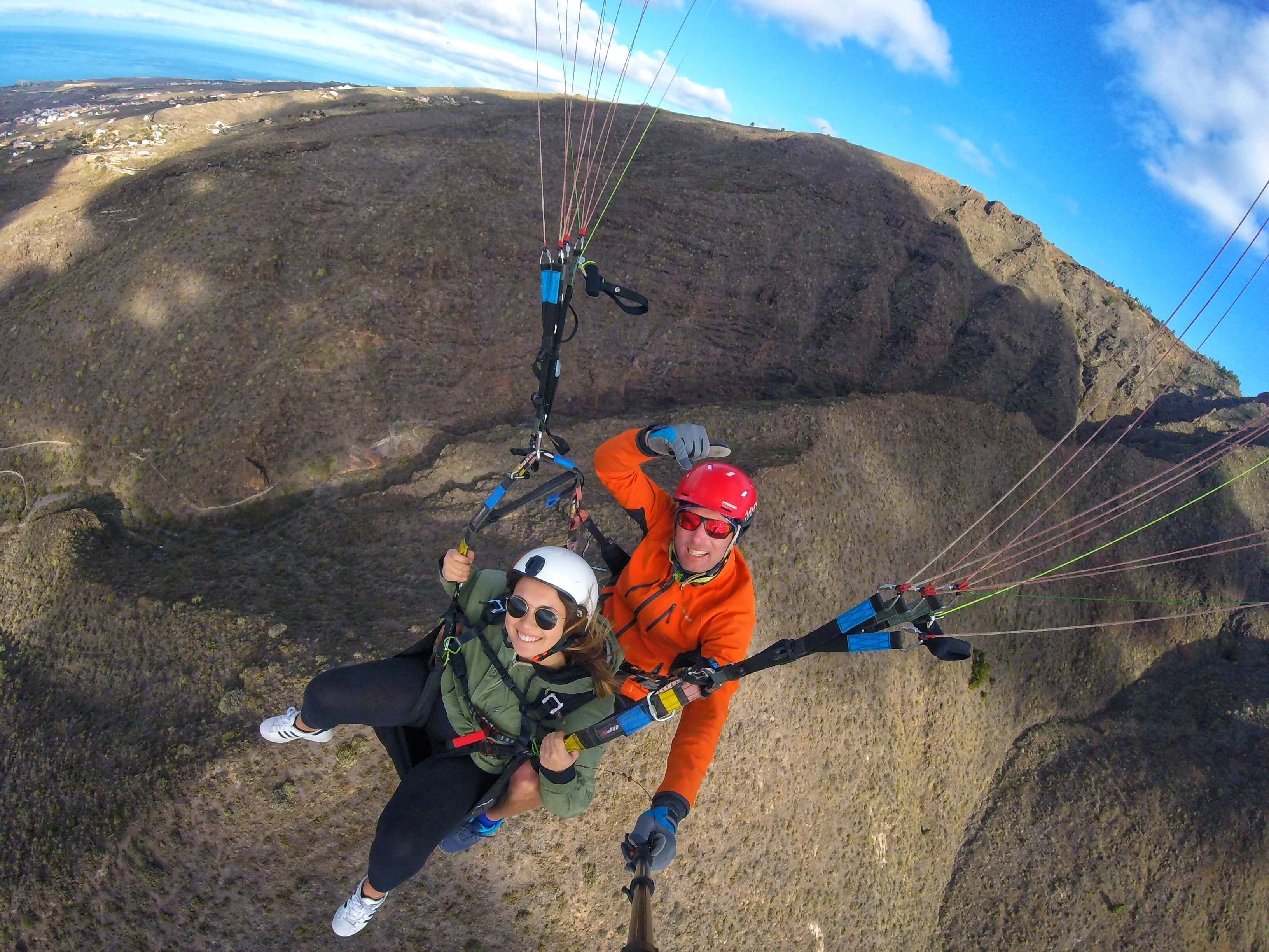 flying in paragliding with professional pilot in tenerife